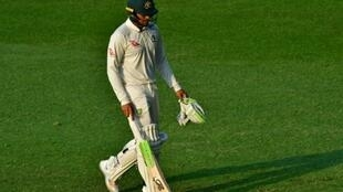 Usman Khawaja leaves the pitch after being dismissed by Muhammad Abbas during day one of the second Test against Pakistan in Abu Dhabi