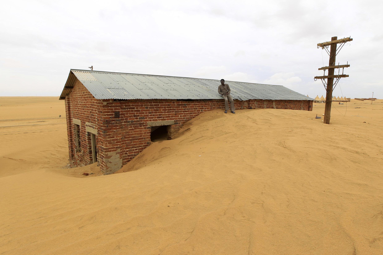 A train station swallowed by the encroaching desert in Sudan.