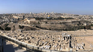 A picture taken with a smartphone using panoramic mode on December 1, 2017 shows a view of Jerusalem from the Mount of Olives.