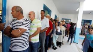 التونسيون ينتخبون رئيسهم في الاقتراع الرئاسي المبكر. 15 سبتمبر/أيلول 2019.