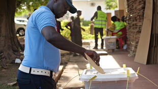 A policeman casts his vote ahead of the first round of the  presidential election at the National Election Commission headquarter in Bissau, Guinea-Bissau, November 21, 2019