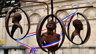 """A """"memorial"""" sculpture, decorated with a ribbon in the colours of the French flag, was unveiled in the gardens of Bordeaux's town hall on December 2, 2019."""