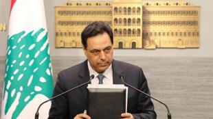 """رئيس الحكومة اللبنانية حسان دياب اثناء إعلانه تخلف لبنان عن دفع مستحقاته من """"اليوروبوندز"""""""
