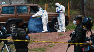 Honduran investigators pictured at the scene of a murder in Tegucigalpa in May 2020
