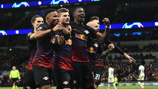 RB Leipzig's German striker Timo Werner (C) celebrates with team mates after scoring the opening goal from the penalty spot on February 19, 2020.