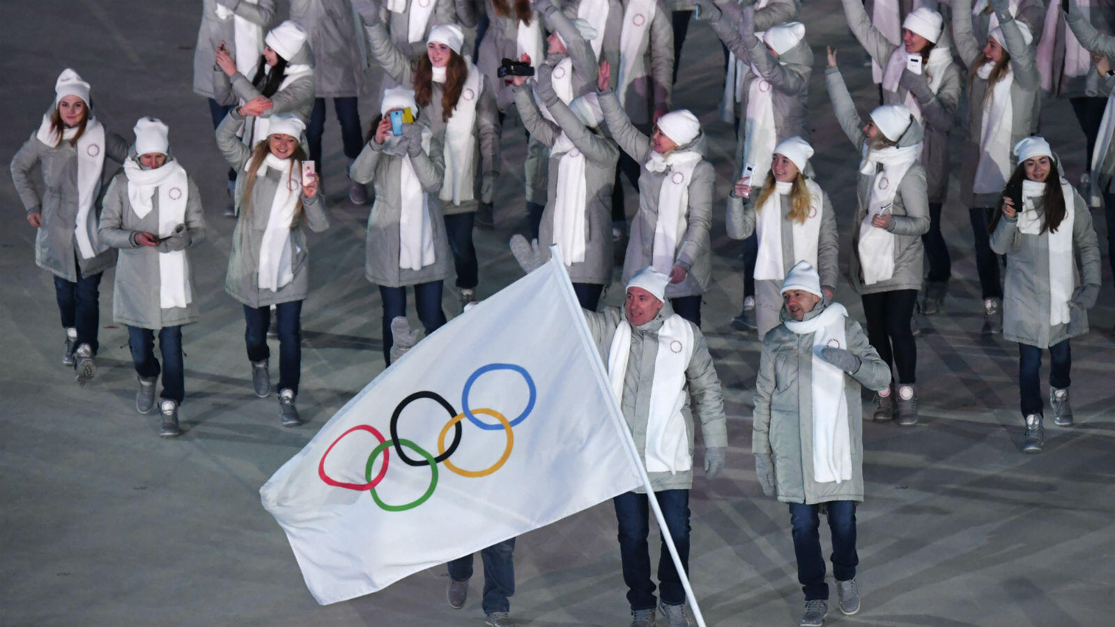 During the parade of delegations, Russian athletes marched under the neutral Olympic banner after Russian athletes were banned due to doping.