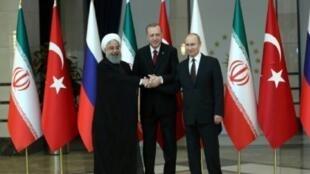 أردوغان وبوتين وروحاني في أنقرة 04 نيسان/أبريل 2018.