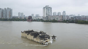 The Guanyinge temple, a 700-year old structure built on a rock in the Yangtze River in Wuhan, is surrounded by flood water