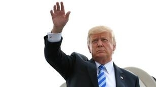 US President Donald Trump steps off Air Force One upon arrival at Yeager Airport in Charleston, West Virginia, on August 21, 2018