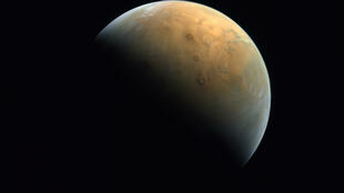 "A handout picture provided by the United Arab Emirates Space Agency (UAESA) taken by the Emirates eXploration Imager (EXI) on board the ""Hope"" probe"