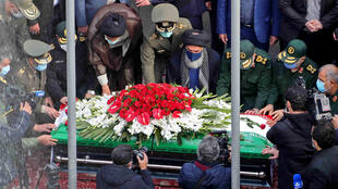 Iranian officials pray over the coffin of slain top nuclear scientist Mohsen Fakhrizadeh during his funeral ceremony in the capital Tehran, in a picture provided by the defence ministry