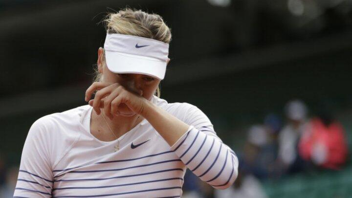 Russia's Maria Sharapova reacts during her match against Czech Lucie Safarova during the fourth round of the French Open in Paris on June 1.