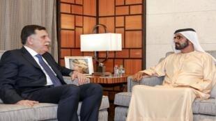 رئيس حكومة الوفاق الليبية فايز سراج مع رئيس الوزراء الإماراتي محمد بن راشد آل مكتوم في دبي 26 فبراير/شباط 2019