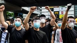Hong Kong protesters have donned masks and goggles, both to protect themselves against tear gas and shield their identity