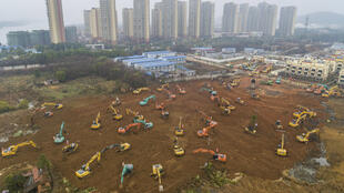This aerial photo on January 24, 2020 shows excavators at the construction site of a new hospital being built to treat patients from a deadly virus outbreak in Wuhan in China's central Hubei province.