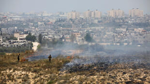 Israeli soldiers inspecting land near the Gaza Strip, in an area where Palestinians have been setting fires by flying balloons loaded with flammable material across the border, June 8, 2018.