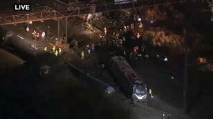 This still image from video courtesy of KYW-TV CBSPhilly shows rescue workers after an Amtrak train derailed late May 12, 2015 near Philadelphia, Pennsylvania