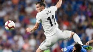 ألويلزي غاريث بايل،صاحب الهدف الثاني لريال مدريد في مرمى خيتافي (2-صفر)، في إحدى محاولاته لمضاعفة غلة الفريق الملكي الأحد 19 آب/أغسطس 2018