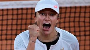 Turn it up: Iga Swiatek celebrates after defeating Simona Halep