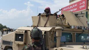 Forces afghanes qui patrouillent dans Kunduz, dans le nord de l'Afghanistan, le 30 avril 2015.