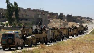Les forces irakiennes sur la route de Tal Afar en juin 2017.