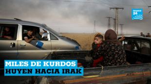 Una mujer con un bebé está sentada en la parte de atrás de un vehículo mientras huyen. Ras al Ain town, Siria, el 9 de octubre de 2019.