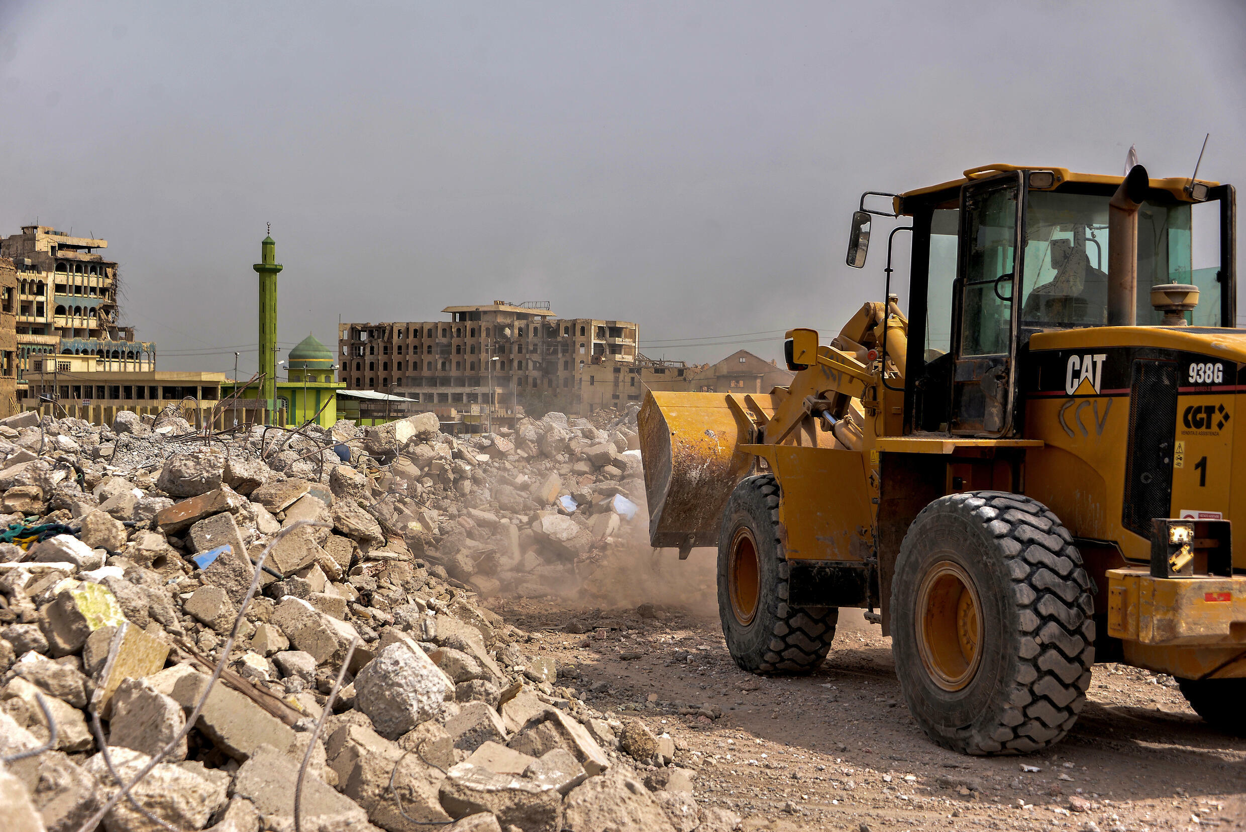 In this file photo, an excavator clears debris in the old city of Mosul on April 6, 2021. Mosul was the last major Iraqi stronghold of the failed