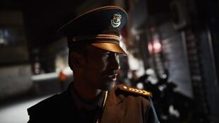 A Uighur security guard photographed in April in a Uighur neighborhood in Aksu, in China's western Xinjiang region.