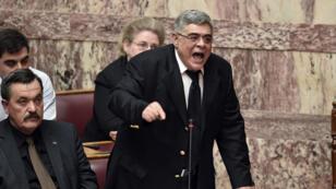 Le fondateur et dirigeant d'Aube dorée Nikos Michaloliakos lors au parlement grec le 30 mars 2015.