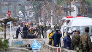 Rescuers are searching for 14 people missing after floods hit the Kumamoto region on Japan's southwestern island of Kyushu