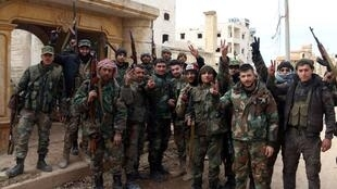 yrian army soldiers gesture in al-Rashideen area in Aleppo province, Syria, February 16, 2020. SANAHandout via REUTERS OK