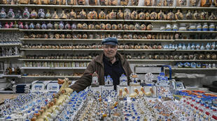 Nikos Degaitis, 86, in his souvenir shop on the iconic Greek island of Mykonos hopes to see the tourists return when the government eases the coronavirus lockdown which has left it virtually deserted