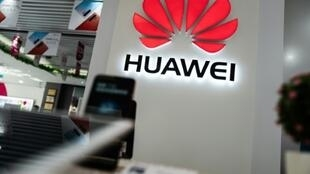 The logo of Huawei, which is facing an effective ban in the United States, is seen at a retail store in Beijing