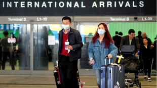Passengers leave LAX after arriving from Shanghai, China, after a positive case of the coronavirus was announced in the Orange County suburb of Los Angeles, California, U.S., January 26, 2020.