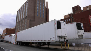 Refrigerated tractor trailers serve as temporary morgues outside the Wyckoff Heights Medical Center during the coronavirus outbreak in the Brooklyn borough of New York City on April 10, 2020.