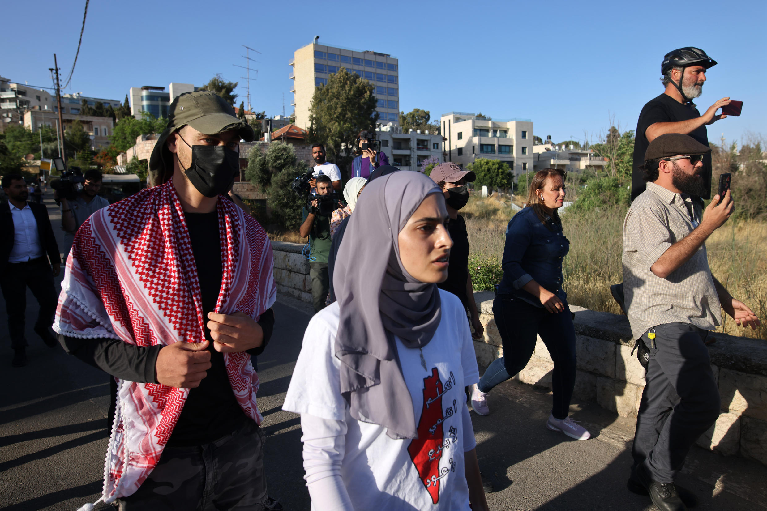 Palestinian activist Mona el-Kurd takes part in a rally to demand the reopening of the Israeli Police checkpoint at the entrance of the Sheikh Jarrah neighbourhood in east Jerusalem on May 29