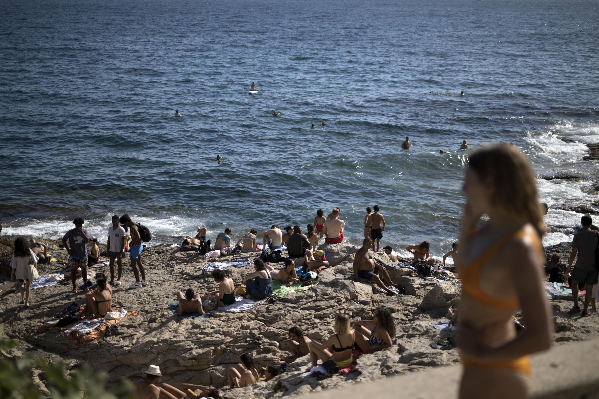 People enjoy the sun at the Malmousque Beach in Marseille, southern France, on July 25,2020.