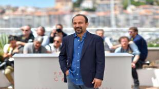 El director iraní Asghar Farhadi posa ante las cámaras en la edición 69 del Festival de Cannes, celebrada en 2016 (imagen de archivo).