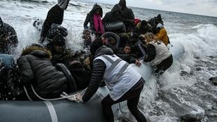 """Greece's government is tightening what it calls """"opaque"""" rules overseeing charities helping asylum seekers"""