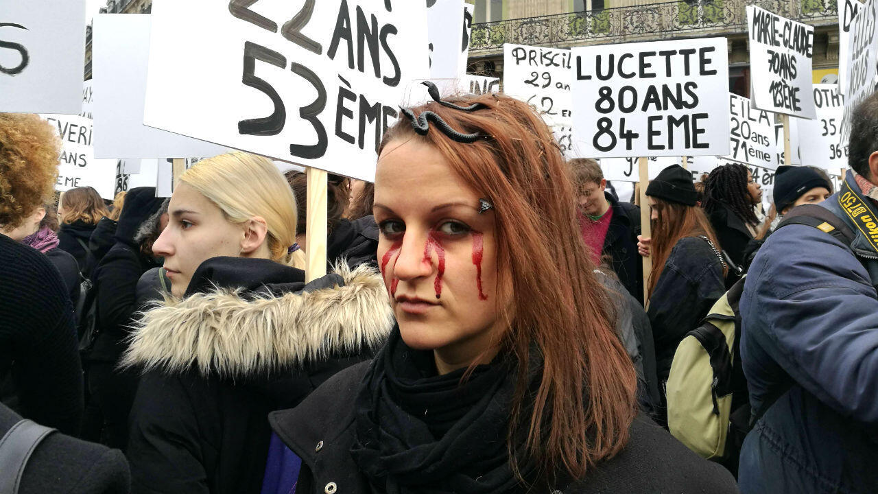 A protester at a demonstration for the elimination of violence against women at Paris's Place de l'Opéra, 23 November 2019.