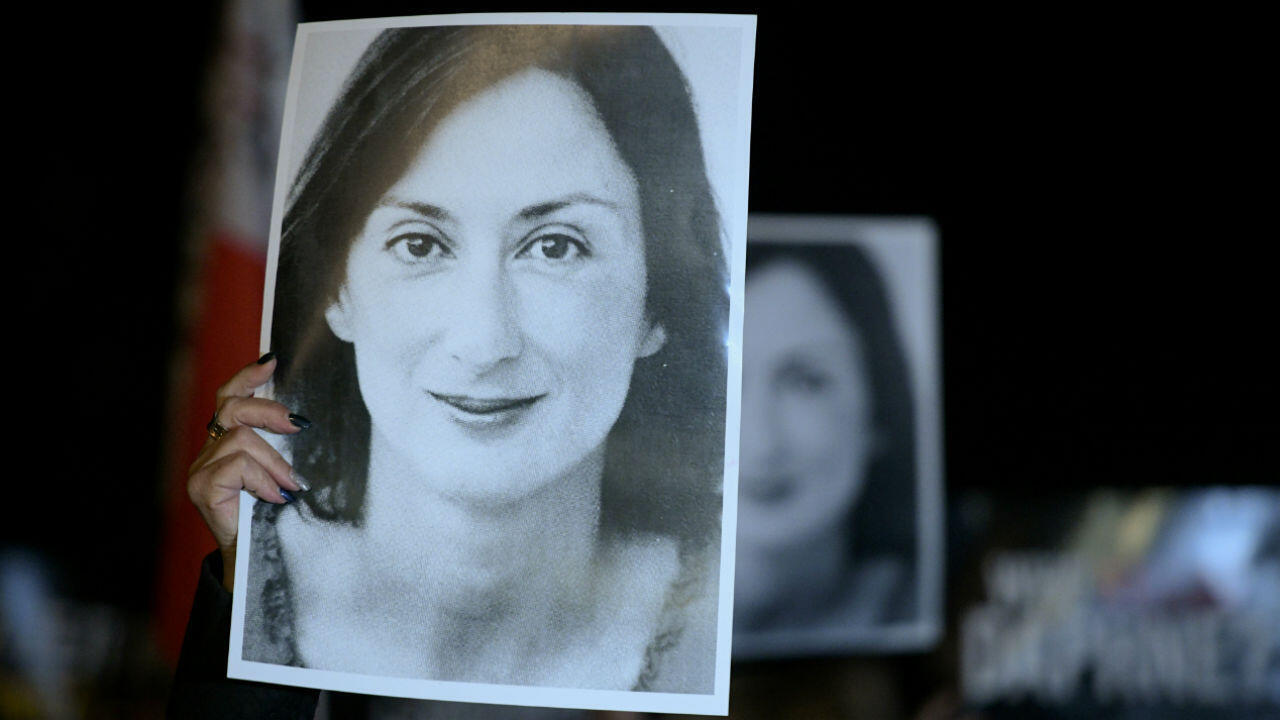 Protesters hold a photo of murdered journalist Daphne Caruana Galizia in the Maltese capital Valletta on November 20, 2019.