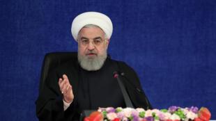 الرئيس الإيراني حسن روحاني يتحدث خلال اجتماع الهيئة الوطنية لمكافحة كوفيد-19، في صورة مؤرخة 13 شباط/فبراير 2021.