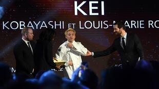 Michelin guide international director Gwendal Poullennec (R) gestures next to chef Kei Kobayashi (C) of restaurant Kei awarded with three star, during the Gala' of Michelin Guide 2020' list of top restaurants and chefs in Paris, on January 27, 2020.