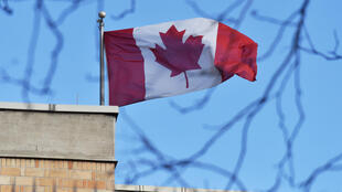 The Canadian flag flies above the Canadian embassy in Beijing: Canadian MPs have voted overwhelmingly to label China's treatment of its Uighur minority a 'genocide'