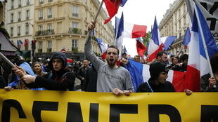 Protesters from far-right movement Generation Identitaire take part in a demonstration against migrants on May 28, 2016 in Paris.