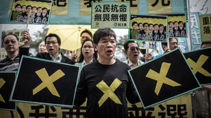 Pro-democracy demonstrators stage a protest outside the government building after Hong Kong's government announced a roadmap for leadership elections which offered no concessions to the city's democracy camp.