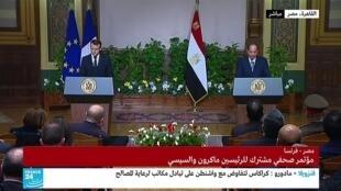 الرئيسان الفرنسي إيمانويل ماكرون والمصري عبد الفتاح السيسي في القاهرة. 28 يناير 2019
