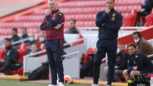 Tough at the bottom: Aston Villa's English head coach Dean Smith (left) and assistant manager John Terry at Anfield