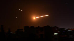 A handout picture released by the official Syrian Arab News Agency (SANA) on February 24, 2020, reportedly shows Syrian air defence intercepting an Israeli missile in the sky over the Syrian capital Damascus.