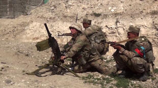 Azeri troops conduct combat operations in this image grab from a video released by the Azerbaijani Defence Ministry on September 28, 2020.